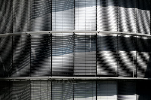 sun shades as part of fenestration system of an office building
