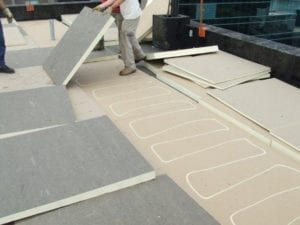 commercial roofers installing Polyiso Rigid Foam insulation on flat roof