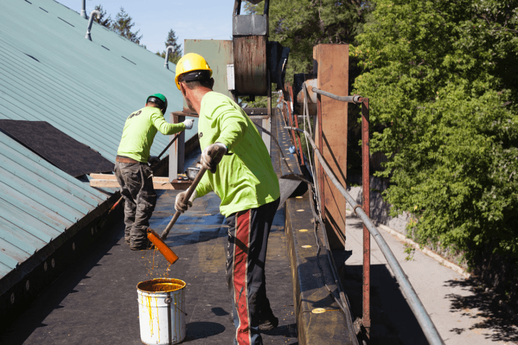 commercial roofers working on a flat roof