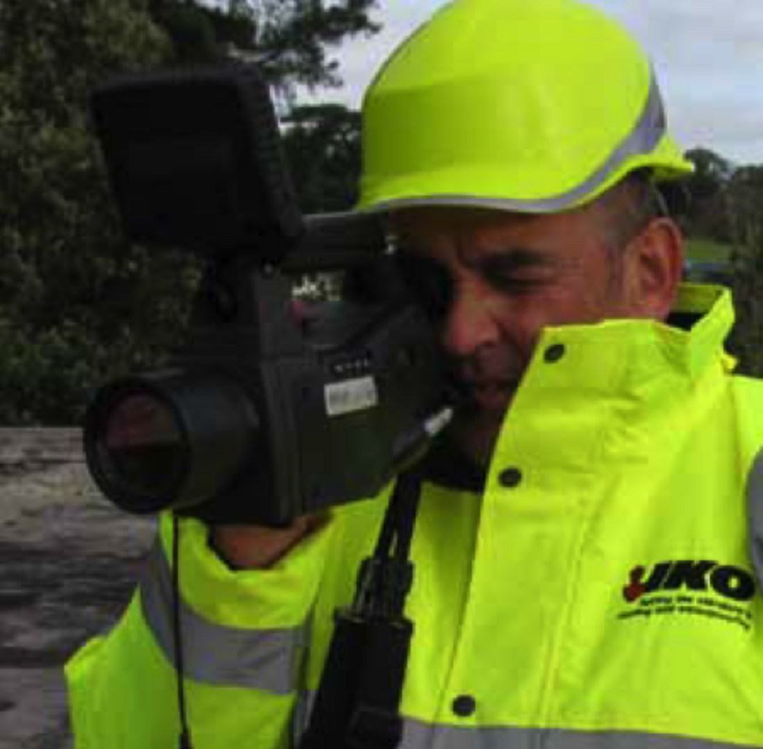 Man holding a Thermographic Camera on a roof