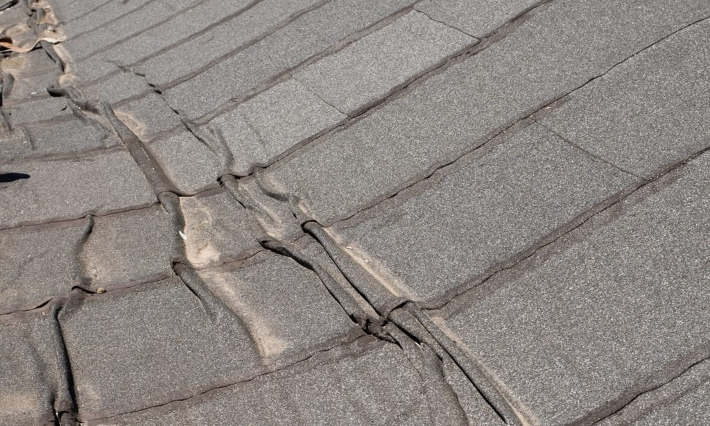 wrinkled and buckled roof membrane