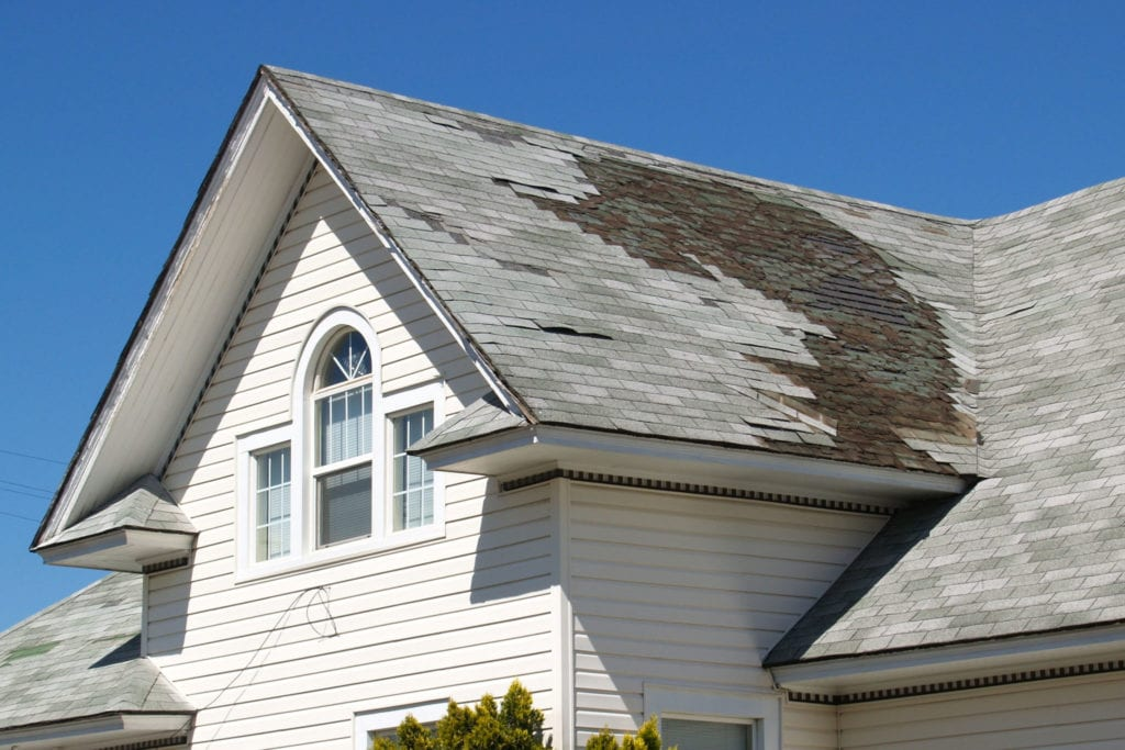 damaged Roof with missing Shingles