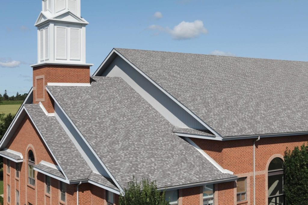 light grey roof shingles to match red toned brickwork of home