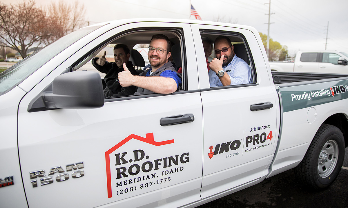 roofers in a pickup truck