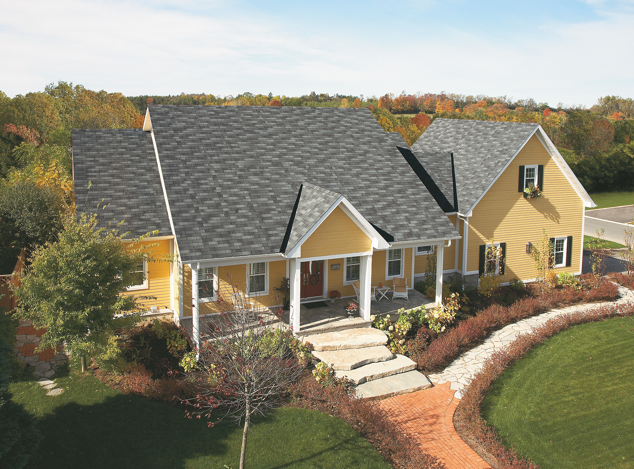 bright yellow siding with charcoal-grey roof shingles