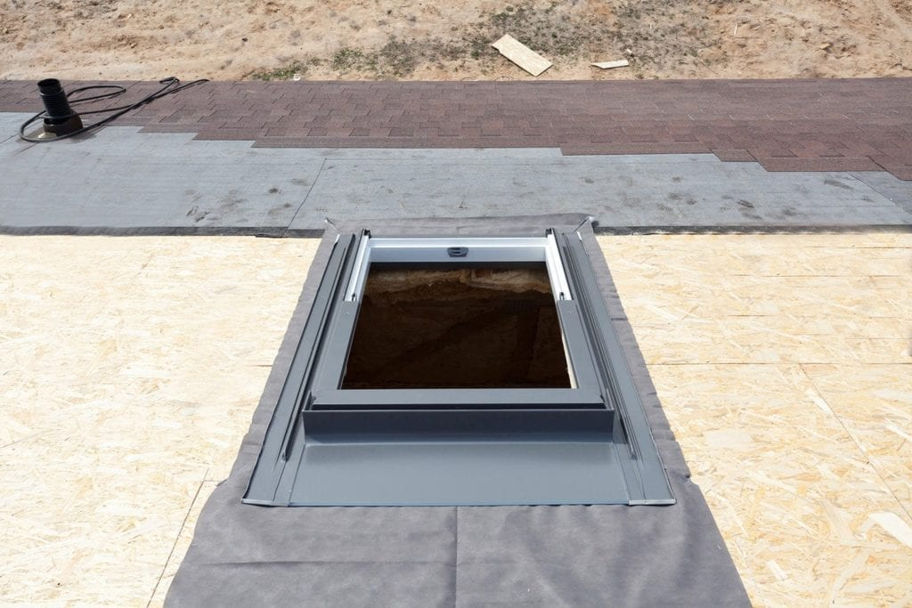 skylight on a roof prior to shingle installation