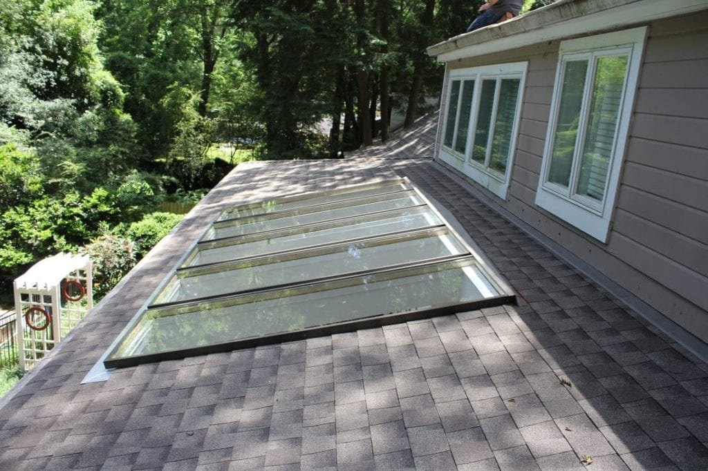 low sloped shingle roof with five skylights