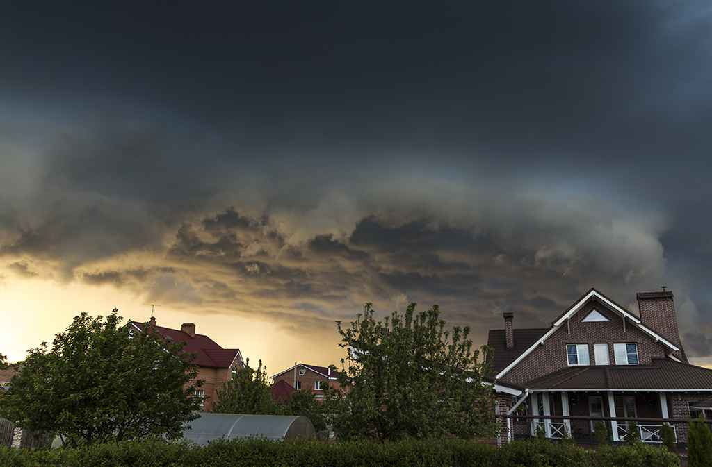 stormy skies over homes