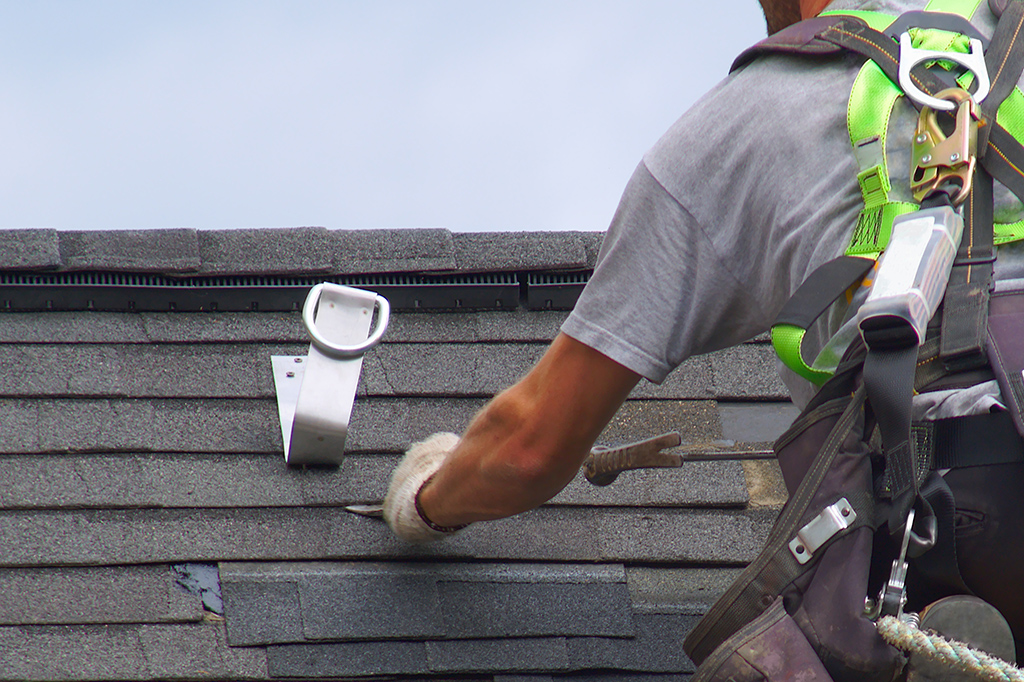 roof safety harness anchor attached to shingle roof