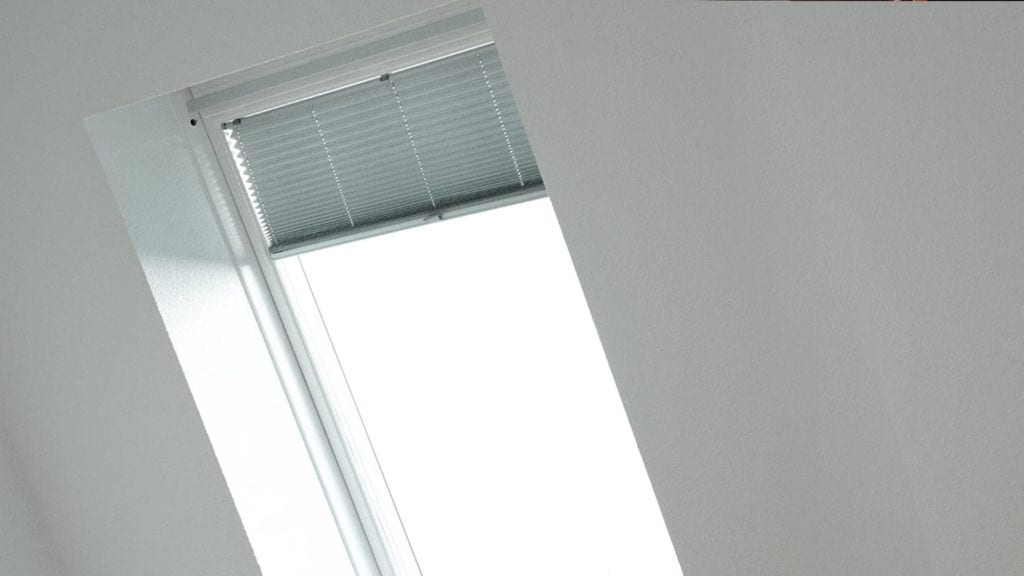 view from inside a home, blinds on a skylight
