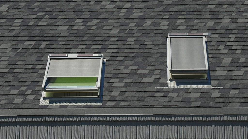 two skylights on a laminated shingle roof